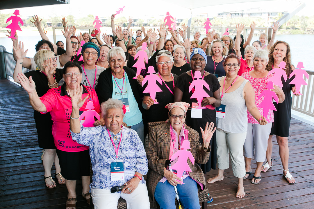 Aboriginal and Torres Strait Islander women hold Pink Lady silhouettes at BCNA summit